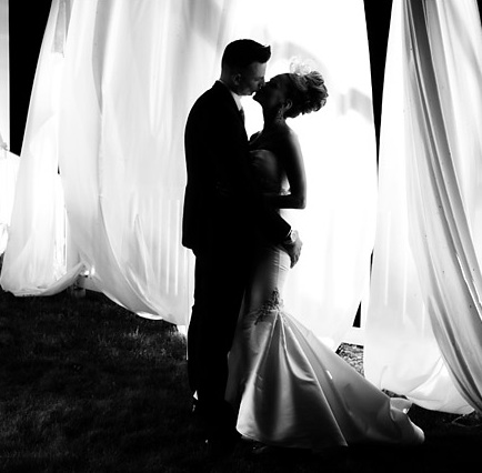 arising images bride groom kiss